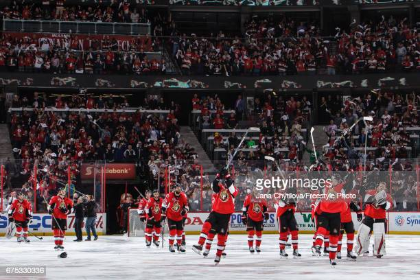 Members of the Ottawa Senators celebrate their double overtime win against the New York Rangers and salute the fans in Game Two of the Eastern...