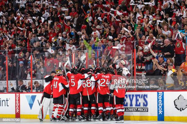 Members of the Ottawa Senators celebrate their overtime win against the Boston Bruins in Game Two of the Eastern Conference First Round during the...