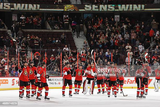 Members of the Ottawa Senators celebrate their win against the Buffalo Sabres during an NHL game at Canadian Tire Centre on February 6 2014 in Ottawa...
