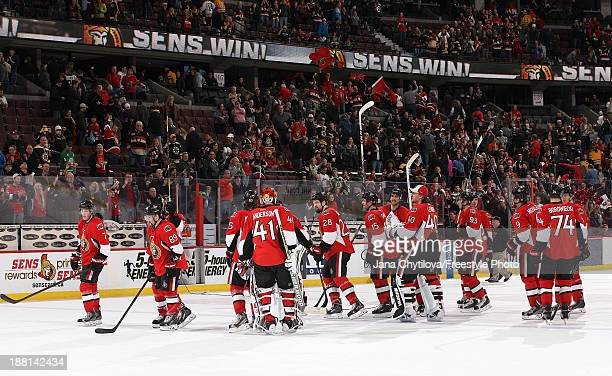 Members of the Ottawa Senators celebrate their win against the Boston Bruins during an NHL game at Canadian Tire Centre on November 15 2013 in Ottawa...