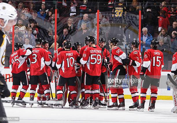 Members of the Ottawa Senators celebrate their win against the Boston Bruins at Canadian Tire Centre on December 27 2015 in Ottawa Ontario Canada