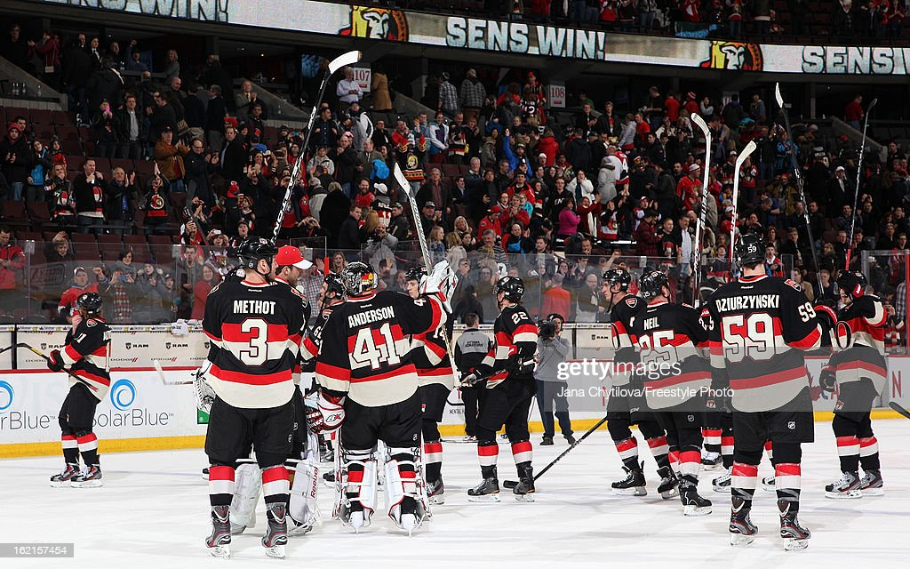 Members of the Ottawa Senators celebrate their win against the New York Islanders during an NHL game at Scotiabank Place on February 19, 2013 in Ottawa, Ontario, Canada.