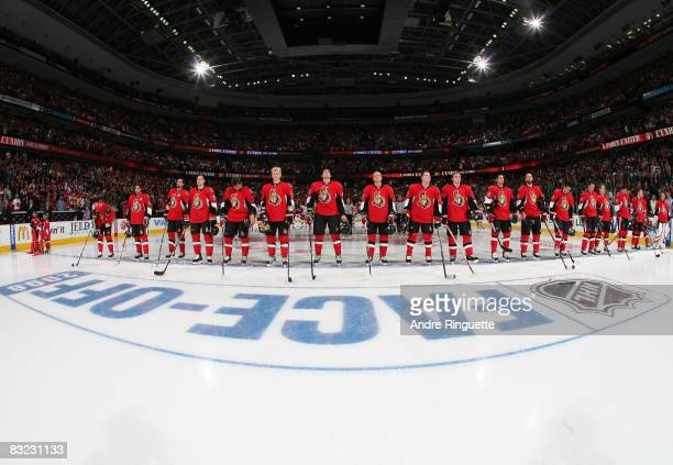 Members of the Ottawa Senators during the stand at the blue line during the singing of the national anthems prior to a game against the Detroit Red...