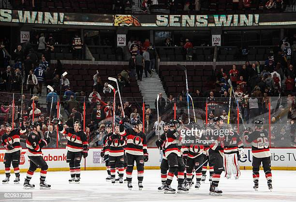 Members of the Ottawa Senators salute the fans after their 10 win the Vancouver Canucks at Canadian Tire Centre on November 3 2016 in Ottawa Ontario...