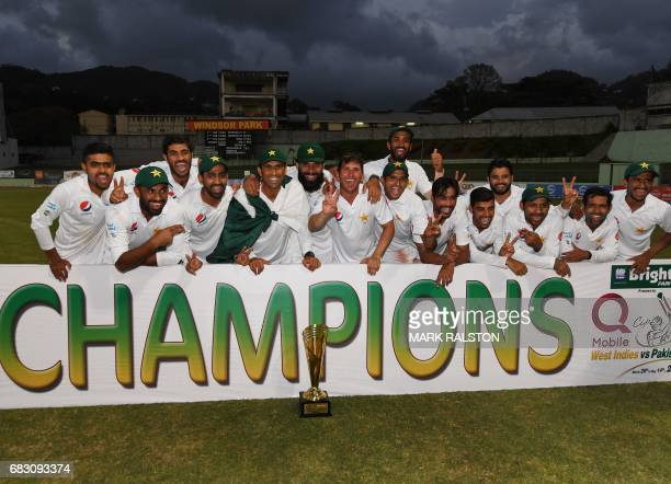 Members of the Pakistan cricket team celebrate after winning the final test match and the series 21 against the West Indies at the Windsor Park...