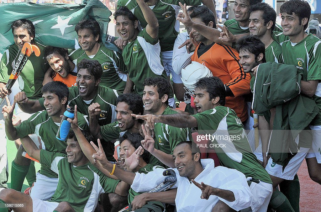 Members of the Pakistan hockey team celebrate winning the bronze medal match against India at the men's Hockey Champions Trophy tournament in Melbourne on December 9, 2012. Pakistan won the match 3-2. IMAGE STRICTLY RESTRICTED TO EDITORIAL USE - STRICTLY NO COMMERCIAL USE AFP PHOTO/Paul CROCK