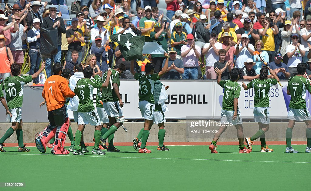 Members of the Pakistan hockey team celebrate winning the bronze medal match against India at the men's Hockey Champions Trophy tournament in Melbourne on December 9, 2012. Pakistan won the match 3-2. IMAGE STRICTLY RESTRICTED TO EDITORIAL USE - STRICTLY NO COMMERCIAL USE. AFP PHOTO/Paul CROCK
