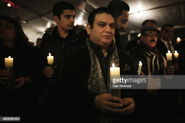 Members of the Pakistani community and local people hold a candlelit vigil at the Pakistani High Commission on December 17 2014 in London England...