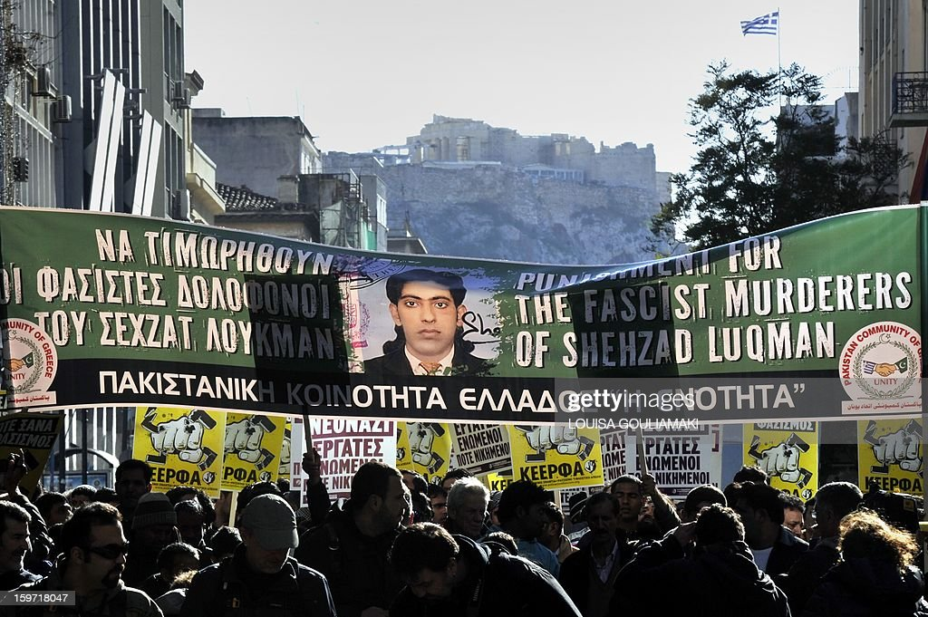 Members of the Pakistani community in Athens carry a banner bearing a picture of a 27 years old Pakistani migrant victim of what appears to be a racism-fuelled crime on January 19, 2013. Hundreds of Greeks, migrants and other nationals marched peacefully against racism and fascism . Nearly 3,000 people joined the rally that was set up by municipalities, organisations, migrant communities and main opposition party radical leftists Syriza. This week, authorities arrested a 29-year-old firefighter and another Greek man aged 25 for the murder of the 27-year-old Pakistani migrant