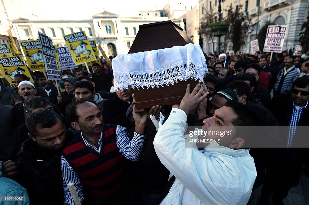 Members of the Pakistani community in Athens carry on January 19, 2013 the coffin of a 27 years old Pakistani migrant victim of what appears to be a racism-fuelled crime. Hundreds of Greeks and other nationals marched peacefully against racism and fascism on January 19. Nearly 3,000 people joined the rally that was set up by municipalities, organisations, migrant communities and main opposition party radical leftists Syriza. This week, authorities arrested a 29-year-old firefighter and another Greek man aged 25 for the murder of the 27-year-old Pakistani migrant.