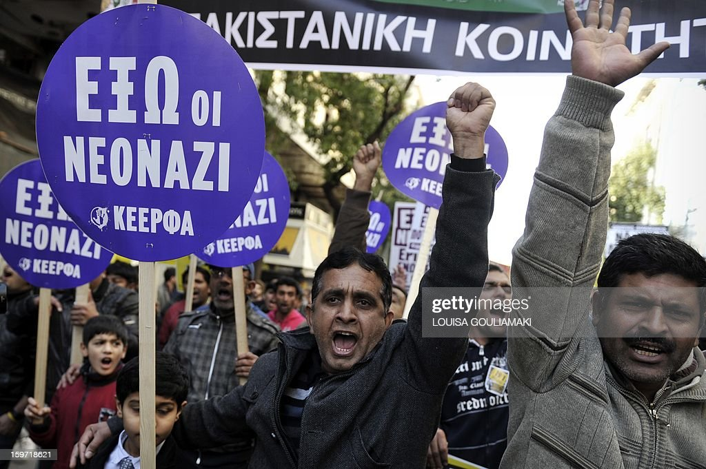 Members of the Pakistani community in Athens march on January 19, 2013 following what appears to be a racism-fuelled crime against a 27-year-old Pakistani migrant. Hundreds of Greeks, migrants and other nationals marched peacefully against racism and fascism . Nearly 3,000 people joined the rally that was set up by municipalities, organisations, migrant communities and main opposition party radical leftists Syriza. This week, authorities arrested a 29-year-old firefighter and another Greek man aged 25 for the murder of the 27-year-old Pakistani migrant AFP PHOTO/ LOUISA GOULIAMAKI