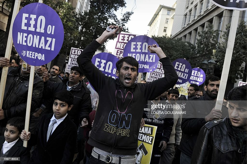 Members of the Pakistani community in Athens protest on January 19, 2013 following what appears to be a racism-fuelled crime against a 27-year-old Pakistani migrant victim. Hundreds of Greeks, migrants and other nationals marched peacefully against racism and fascism . Nearly 3,000 people joined the rally that was set up by municipalities, organisations, migrant communities and main opposition party radical leftists Syriza. This week, authorities arrested a 29-year-old firefighter and another Greek man aged 25 for the murder of the 27-year-old Pakistani migrant AFP PHOTO/ LOUISA GOULIAMAKI