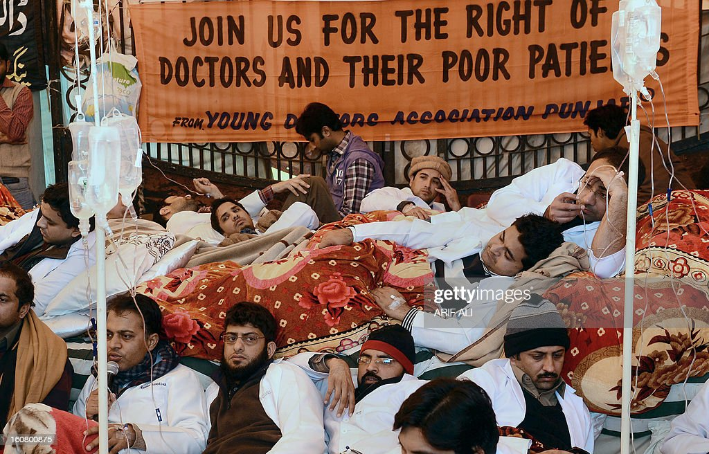 Members of the Pakistani Young Doctors Association (YDA) sit on a hunger strike at their protest camp in Lahore on February 6, 2013. The Young Doctors Association staged a hunger strike camp to press their demand for the release of their colleagues who have been arrested during an earlier protest for wage hike. AFP PHOTO/Arif ALI