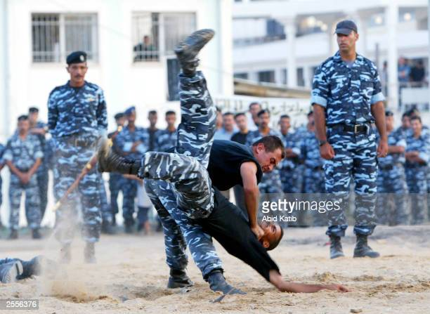 Members of the Palestinian antiriot police demonstrate martial arts during the graduation ceremony on October 2 2003 in Gaza City Gaza Strip The...