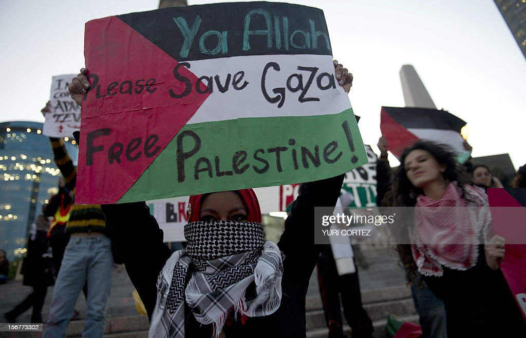 Members of the Palestinian community and Mexicans participate in a protest against Israeli strikes in Gaza at the Independence Angel square in Mexico City on November 20, 2012. The United States signalled that a Gaza truce could take days to achieve after Hamas, the Palestinian enclave's ruling Islamist militants, backed away from an assurance that it and Israel would stop exchanging fire within hours. AFP PHOTO/YURI CORTEZ