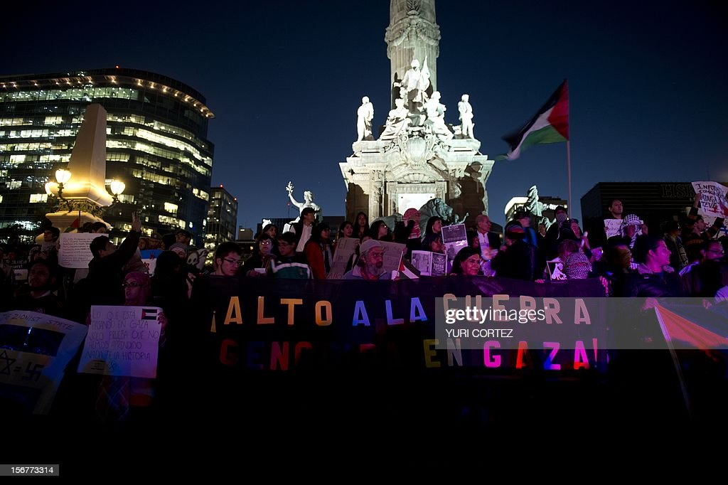 Members of the Palestinian community and Mexicans participate in a protest against Israeli strikes in Gaza at the Independence Angel square in Mexico City on November 20, 2012. The United States signalled that a Gaza truce could take days to achieve after Hamas, the Palestinian enclave's ruling Islamist militants, backed away from an assurance that it and Israel would stop exchanging fire within hours.