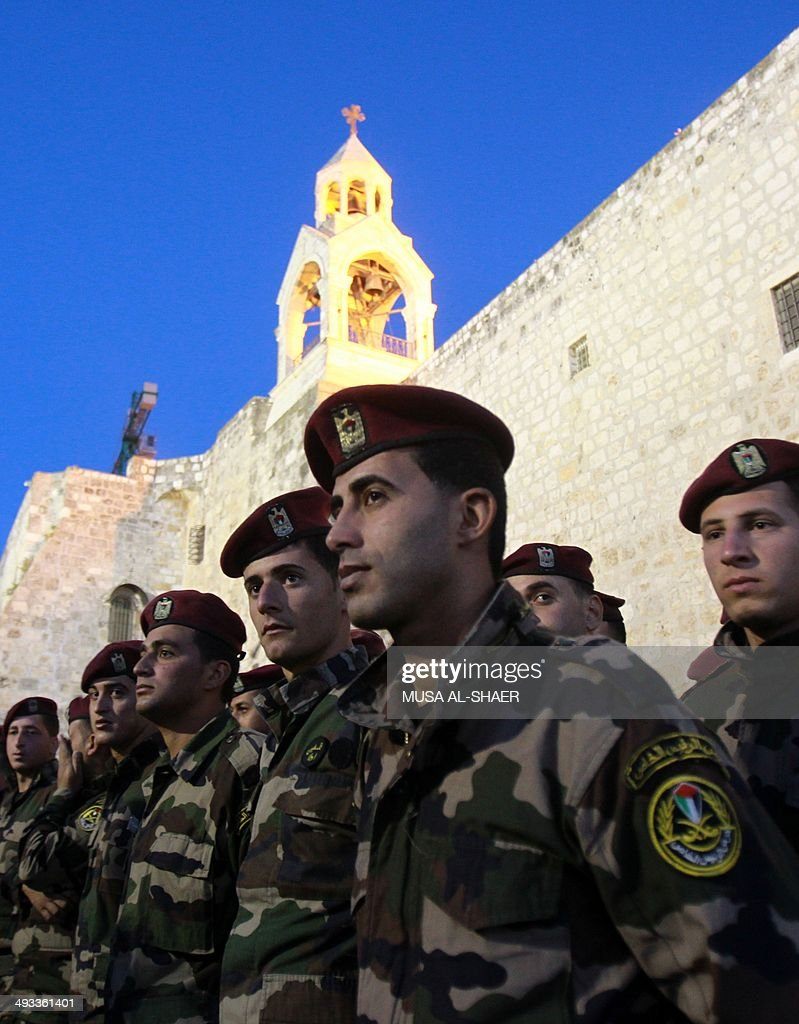 Members of the Palestinian presidential guard, take part in a training session outside the church of Nativity -revered as the site of Jesus' birth- in the West Bank city of Bethlehem on May 23, 2014, two days ahead of a the top-level visit by Pope Francis to the Holy Land. Israelis and Palestinians are putting the finishing touches on a flurry of festive preparations for the Pope's May 24-26 visit in Jordan, Israel and the Palestinian territories.