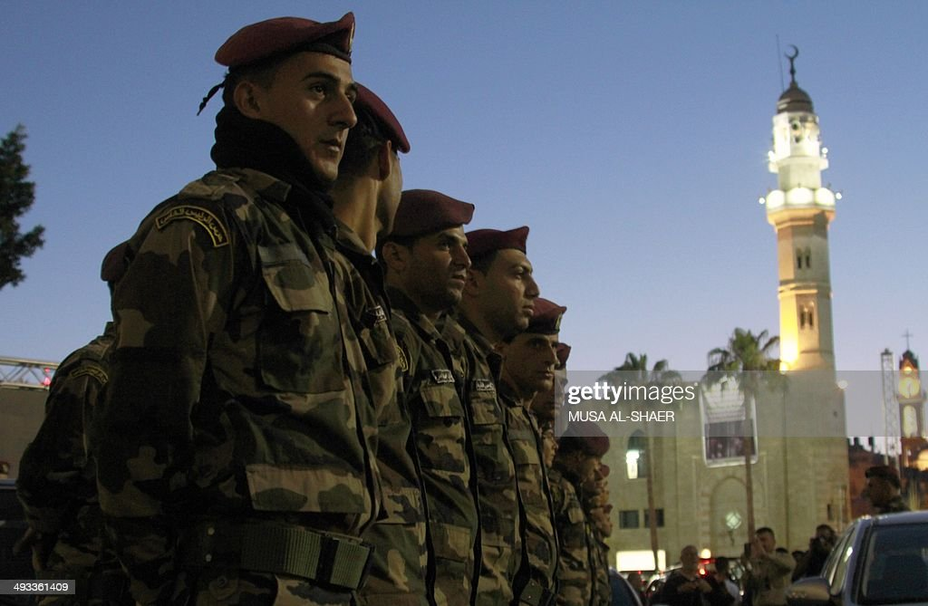 Members of the Palestinian presidential guard, take part in a training session outside the church of Nativity -revered as the site of Jesus' birth- in the West Bank city of Bethlehem on May 23, 2014, two days ahead of a the top-level visit by Pope Francis to the Holy Land. Israelis and Palestinians are putting the finishing touches on a flurry of festive preparations for the Pope's May 24-26 visit in Jordan, Israel and the Palestinian territories. AFP PHOTO/ MUSA AL-SHAER