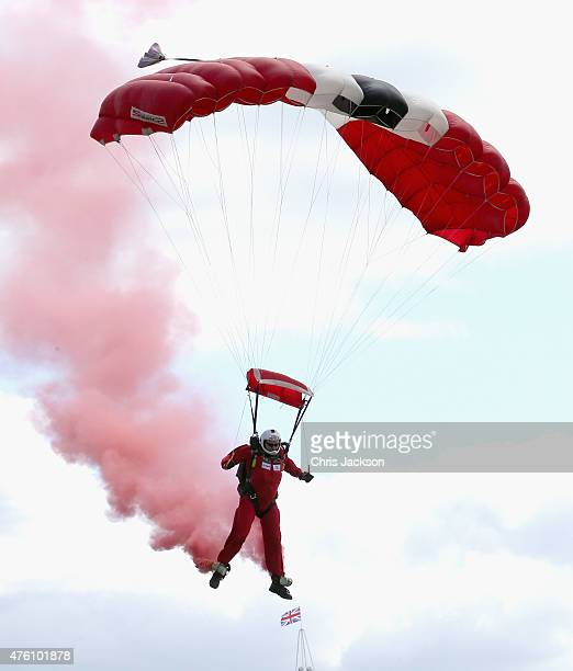 Members of the parachute regiment arrive at the Investec Derby festival at Epsom Racecourse on June 6 2015 in Epsom England