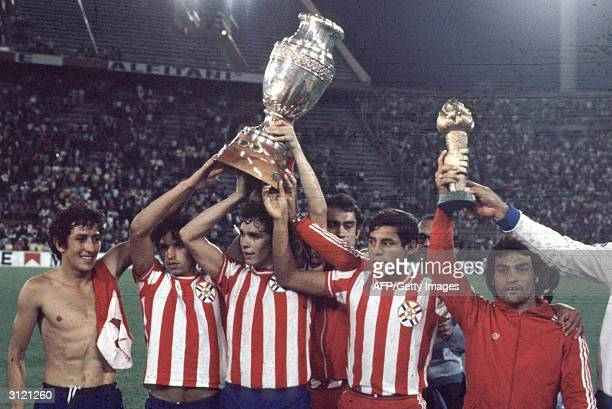 Members of the Paraguayan football team raising the throphy after winning the Copa America in 1979