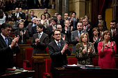 Members of the Parliament of Catalonia applaud as the President of Catalonia Artur Mas applauds after being resworn in as President of Catalonia on...