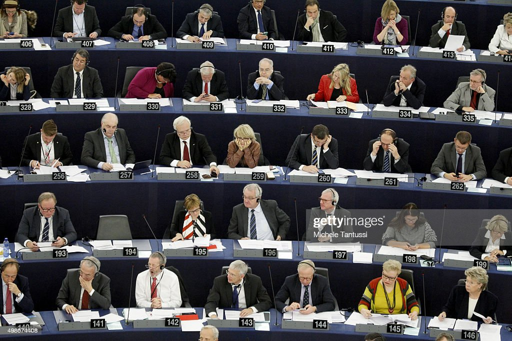 Members of the parliament vote in the plenary room of the European Parliament during the debate on the measures to fight terrorism November 25 2015...