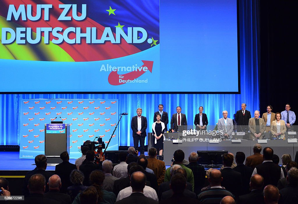 Members of the party leadership sing the german national anthem at the end of the german right wing party Alternative for Germany (AfD party congress at the Stuttgart Congress Centre ICS on May 1, 2016 in Stuttgart, southern Germany. Germany's right-wing populist AfD adopted an anti-Islam policy in a manifesto that also demands curbs to immigration, as a poll showed it is now the country's third strongest party. / AFP / Philipp GUELLAND