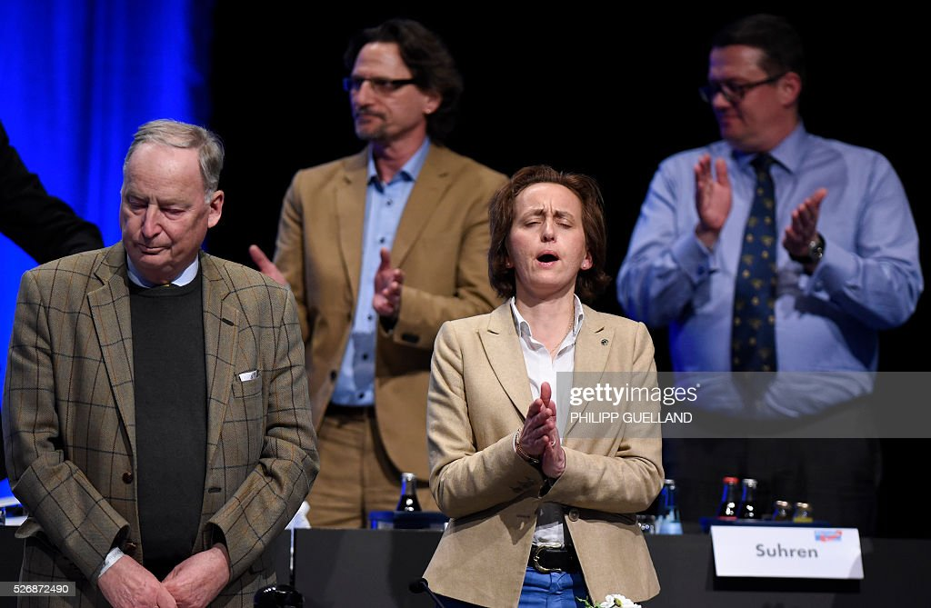 Members of the party leadershipincluding Alexander Gauland (L) and Beatrix von Storch sing the german national anthem at the end of the german right wing party Alternative for Germany (AfD party congress at the Stuttgart Congress Centre ICS on May 1, 2016 in Stuttgart, southern Germany. Germany's right-wing populist AfD adopted an anti-Islam policy in a manifesto that also demands curbs to immigration, as a poll showed it is now the country's third strongest party. / AFP / Philipp GUELLAND