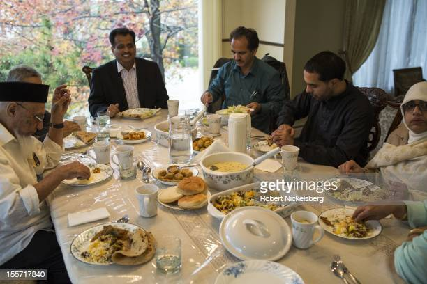 Members of the Patel family from Gujarat India sit for a meal during their traditional Eid alAdha gathering in Englewood Cliffs New Jersey Eid alAdha...