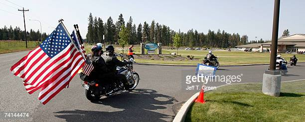 Members of the Patriot Guard Riders arrive at the funeral service of US Army Reserve Cpl Kelly B Grothe to form a flag line and show support at the...