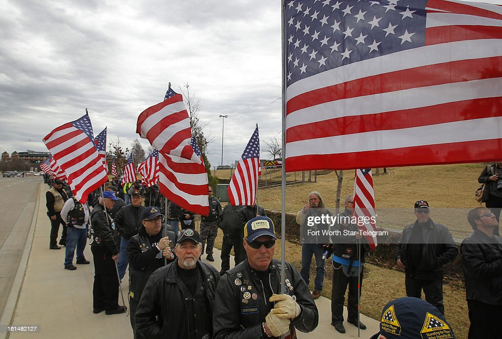 Members of the Patriot Guard Riders wait to enter Cowboys Stadium for the funeral of Chris Kyle in Arlington, Texas, Monday, February 11, 2013. Kyle was a highly decorated former Navy SEAL sniper who was shot and killed at a shooting range last week.