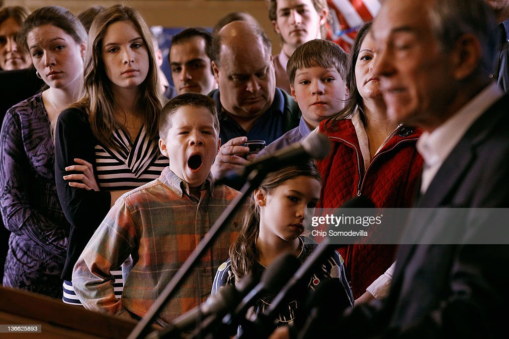 Members of the Peik family (clockwise from top L) Kristen, 20; Katie, 18; Stephen, 13; Teresa,; and twin brother Alex, 10, listen to Republican presidential candidate, U.S. Rep. <a gi-track='captionPersonalityLinkClicked' href=/galleries/search?phrase=Ron+Paul&family=editorial&specificpeople=2300665 ng-click='$event.stopPropagation()'>Ron Paul</a> (R-TX) address a group of homeschool supporters at the Lawrence Barn on the day before the state primary January 9, 2012 in Hollis, New Hampshire. According to recent state-wide polls, Paul is in second place in a field of six hopefuls but still lags behind former Massachusetts Gov. Mitt Romney by more than 20 percentage points in this New England state.