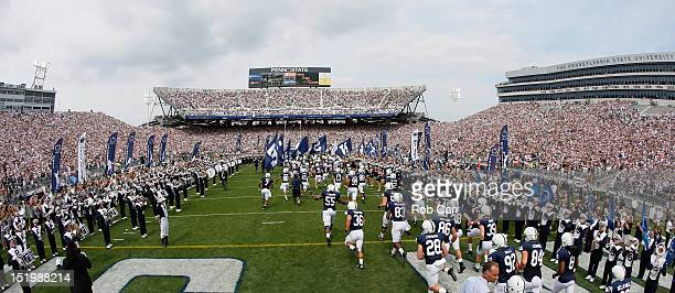 Members of the Penn State Nittany Lions take the field prior to their game against the Ohio Bobcats at Beaver Stadium on September 1 2012 in State...