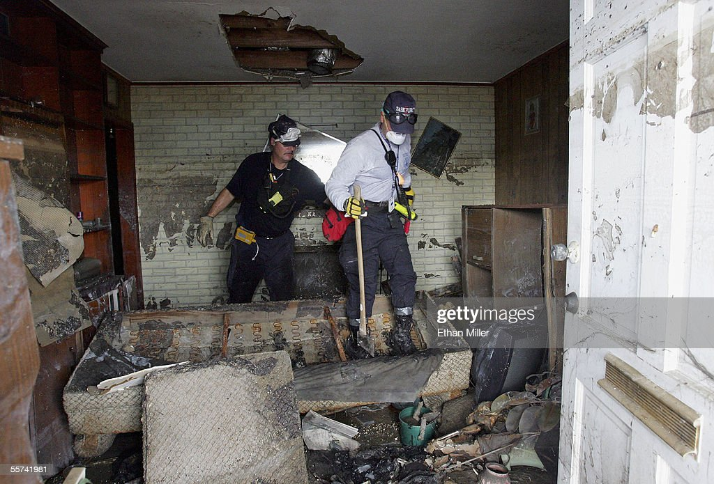 Members of the Pennsylvania Task Force-1 Urban Search & Rescue team carefully pick their way through a home on Wildair Drive as they go door-to-door searching for victims of Hurricane Katrina in the Gentilly Terrace District September 22, 2005 in New Orleans, Louisiana. The body count from Hurricane Katrina has risen to over 1,000, although the search may be hampered by the threat from Hurricane Rita.