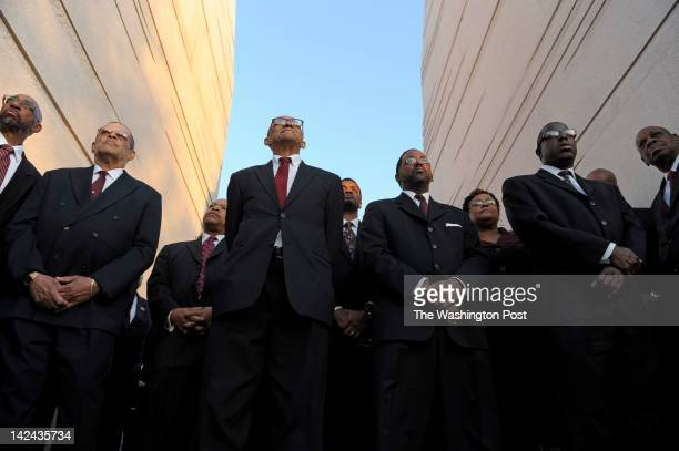 Members of The People's Community Baptist Church Men's Choir of Silver Spring Md stand tall during a candlelight vigil ceremony at the Martin Luther...