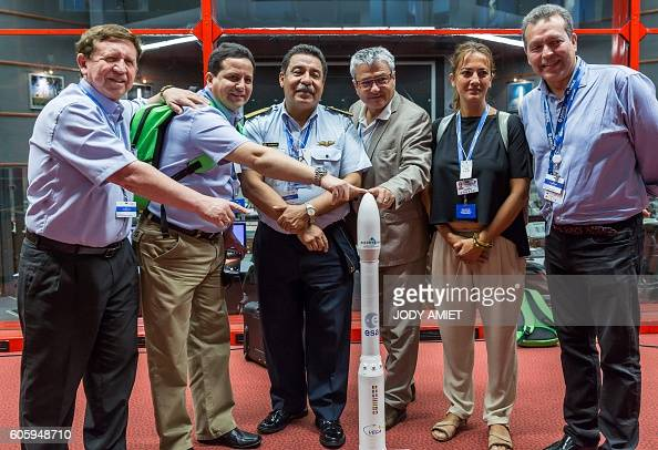 Members of the Peruvian Space Agency pose with Vega rocket model as they celebrate the success of the Vega rocket launching from the European...