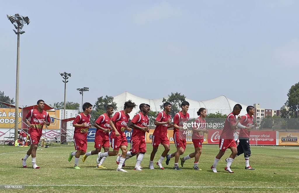 Members of the Peruvian U20 national football team jog during a training session in Lima on December 28, 2012 ahead of the U-20 South American Championship which will be held in Argentina from January 9, 2013 to February 3. The tournament grants four tickets for the 2013 FIFA U-20 World Cup to be held in Turkey.