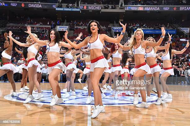 Members of the Philadelphia 76ers Dance Team get the crowd pumped up against the Detroit Pistons at Wells Fargo Center on March 18 2015 in...