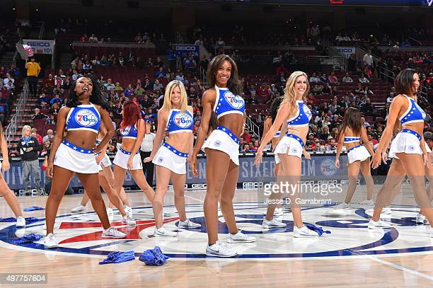 Members of the Philadelphia 76ers dance team get the crowd pumped up against the Indiana Pacers at Wells Fargo Center on November 18 2015 in...