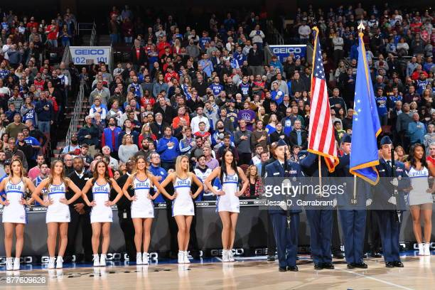 Members of the Philadelphia 76ers dance team look on while playing the national anthem against the Portland Trail Blazers at Wells Fargo Center on...