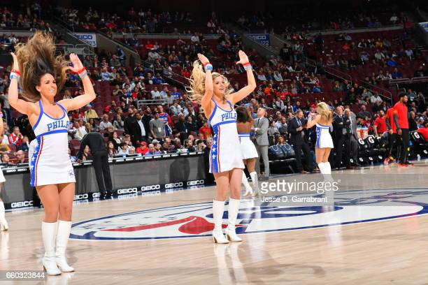 Members of the Philadelphia 76ers Dance Team perform during a timeout against the Atlanta Hawks at Wells Fargo Center on March 29 2017 in...