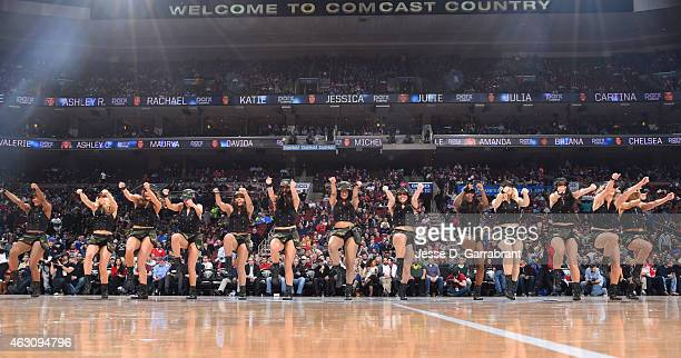 Members of the Philadelphia 76ers Dance Team perform for the crowd against the Golden State Warriors at Wells Fargo Center on February 9 2015 in...