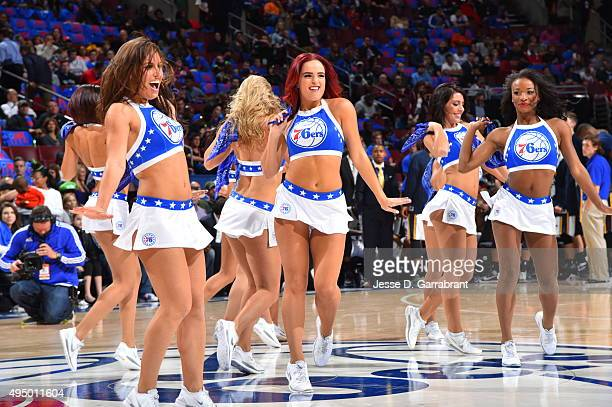 Members of the Philadelphia 76ers dance team perform for the crowd against the Utah Jazz at Wells Fargo Center on October 30 2015 in Philadelphia...
