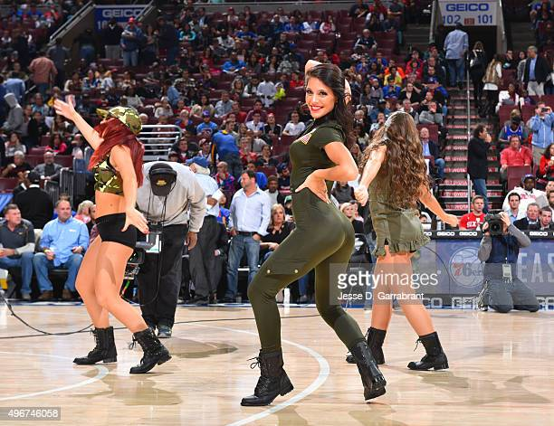 Members of the Philadelphia 76ers dance team perform for the crowd against the Toronto Raptors at Wells Fargo Center on November 11 2015 in...