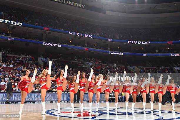 Members of the Philadelphia 76ers dance team perform for the crowd against the Dallas Mavericks at Wells Fargo Center on November 16 2015 in...
