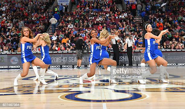 Members of the Philadelphia 76ers Dance Team perform for the crowd against the Boston Celtics at Wells Fargo Center on December 3 2016 in...