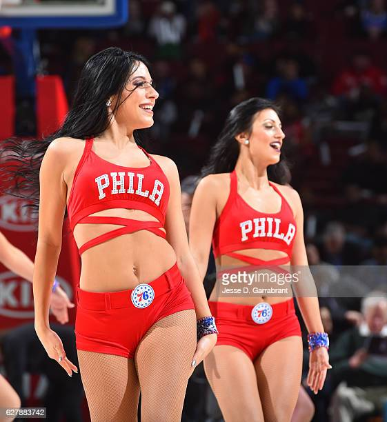 Members of the Philadelphia 76ers dance team perform for the crowd against the Denver Nuggets at Wells Fargo Center on December 5 2016 in...
