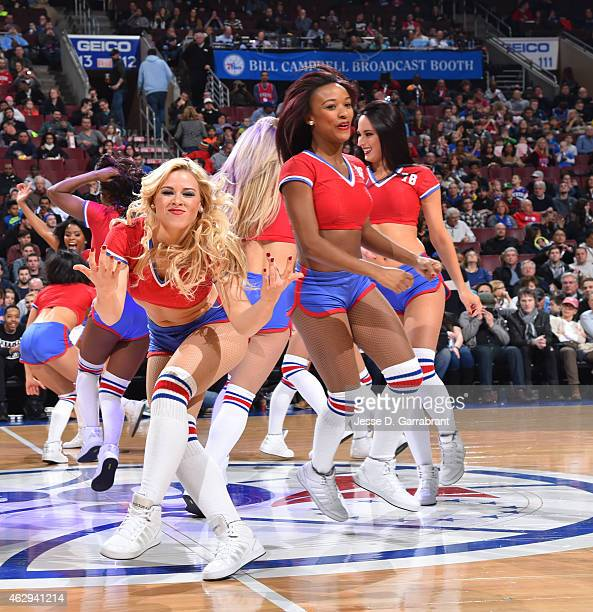 Members of the Philadelphia 76ers dance team performs for the crowd against the Charlotte Hornets at Wells Fargo Center on February 7 2015 in...