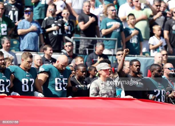 Members of the Philadelphia Eagles link arms during the national anthem before the game against the New York Giants on September 24 2017 at Lincoln...