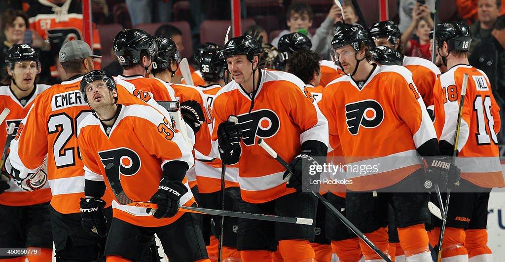 Members of the Philadelphia Flyers celebrate after defeating the Ottawa Senators 5-2 on November 19, 2013 at the Wells Fargo Center in Philadelphia, Pennsylvania.